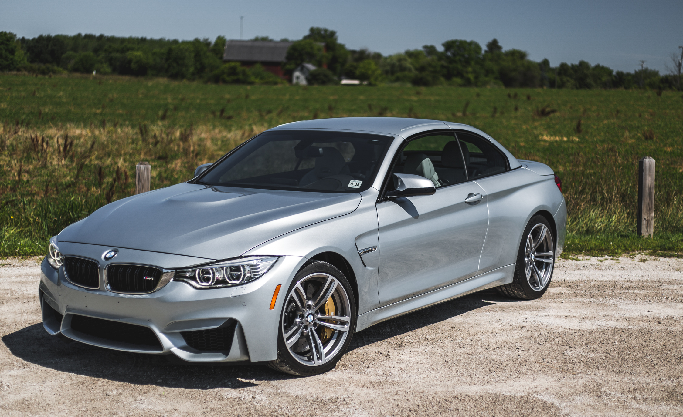 2015 BMW M4 Convertible Top Up Exterior Front and Side
